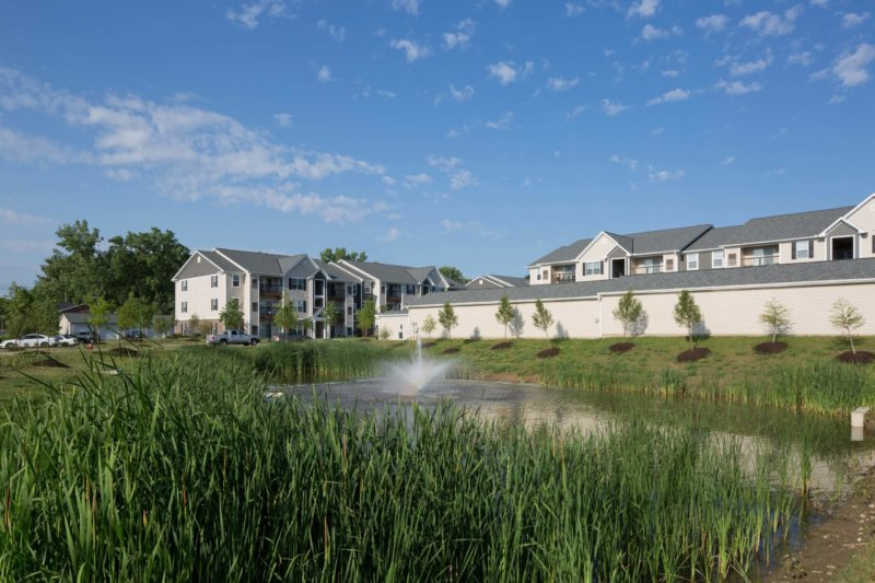 French Mill apartments with pond outside