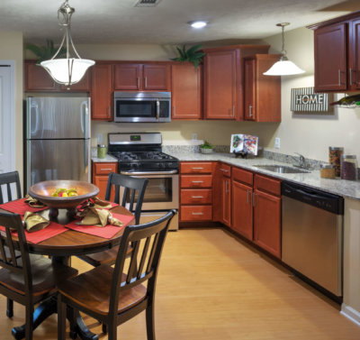 Apartment kitchen with cherry cabinets and granite countertops